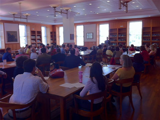 Students and faculty listening to Dr. Campbell speak