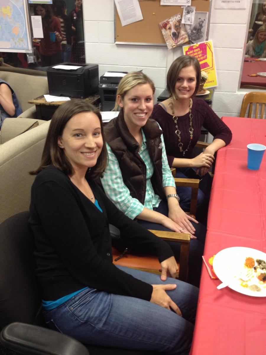 Faculty and students at Thanksgiving potluck event