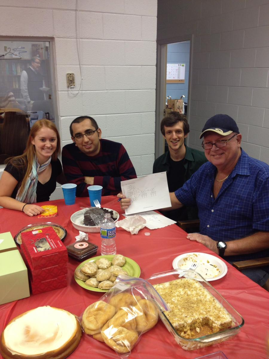 Faculty and students at potluck event