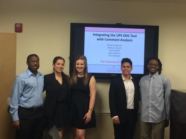 Undergraduate lab students present a project to UPS representatives